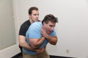 Choking rescue during first aid and CPR class